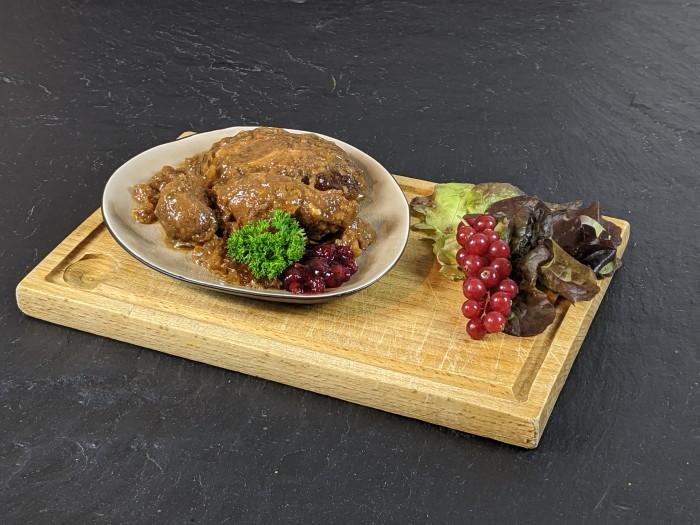 Schweine-Bäckchen gegart in Sauce